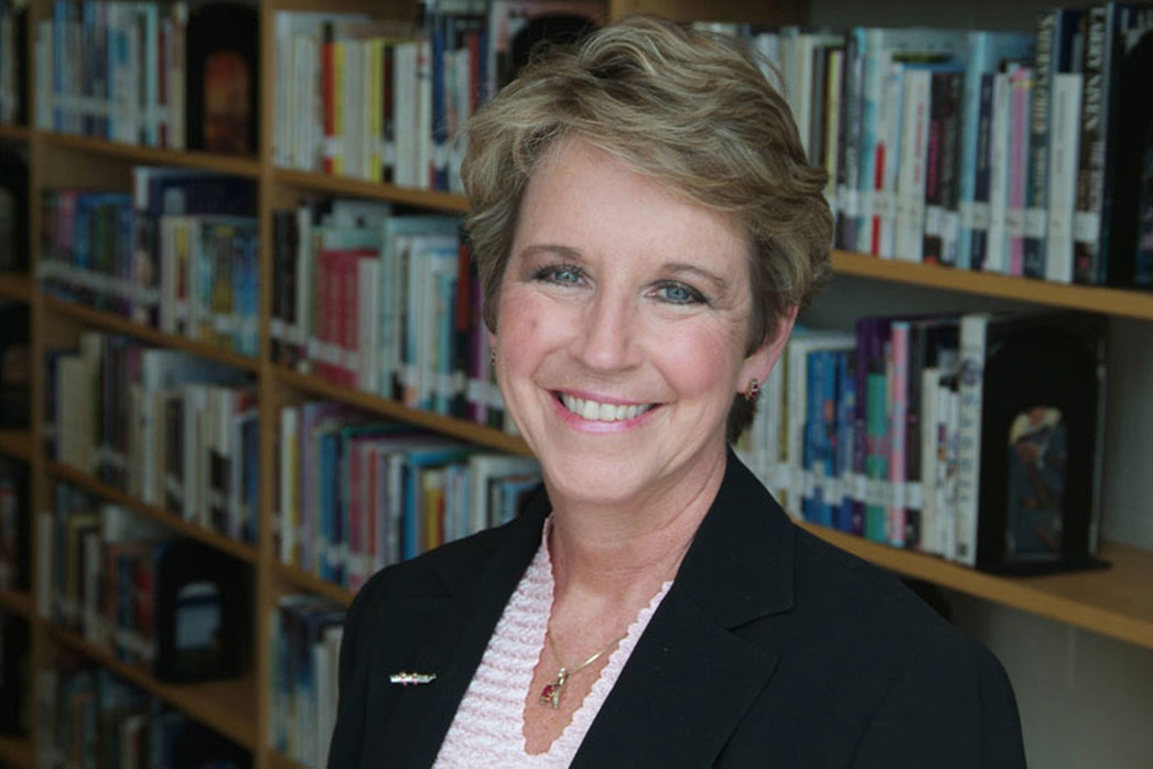 Who is Dr Sandy Husk, AVID's CEO?